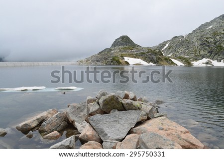 High mountain dam in a cold sullen day - stock photo