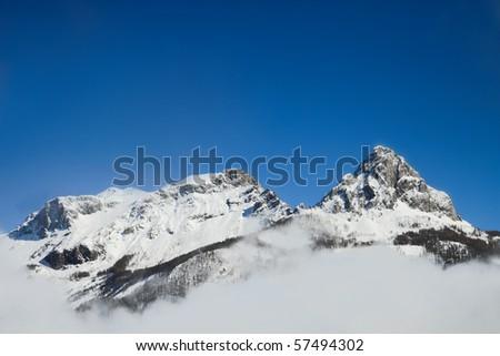 High mountain in snow - stock photo