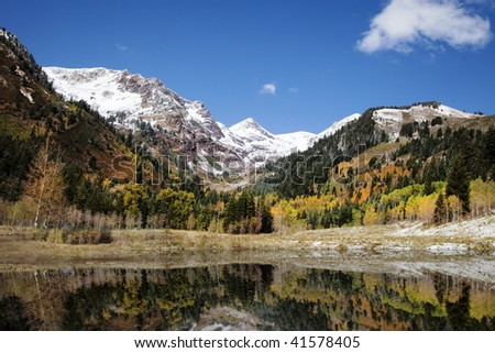 High mountain lake in the fall showing autumn colors reflected in the water Americana