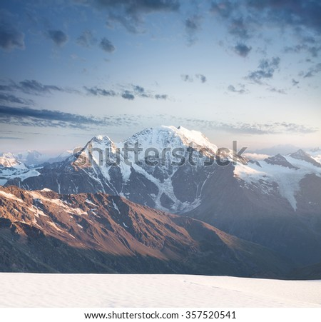 High mountain peak during sunrise. Beautiful natural landscape in the summer time