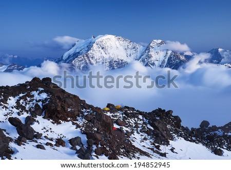 High mountain peak in clouds. Beautiful natural landscape - stock photo