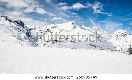 High mountain peaks in the italian alpine arc, in a bright day and lot of candid snow. Ski resort of La Thuile and La Rosiere, on the border Italy France. Mont Blanc summit (4810 m) at the horizon. - stock photo