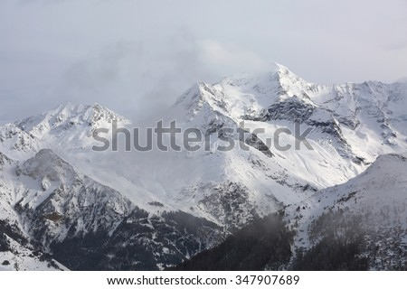 High mountain range in winter - stock photo