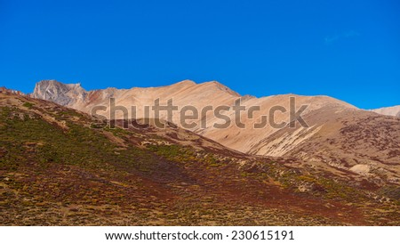 high mountains against blue sky and white clouds, Tibet, China - stock photo