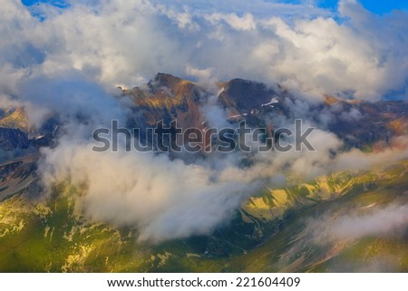 high mountains in a clouds - stock photo