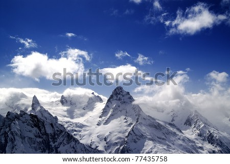 High mountains in cloud. Caucasus. Dombay. - stock photo