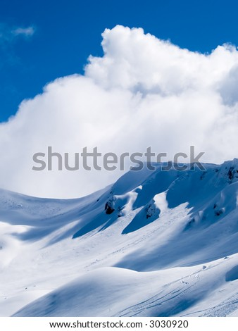 High mountains in snow - stock photo