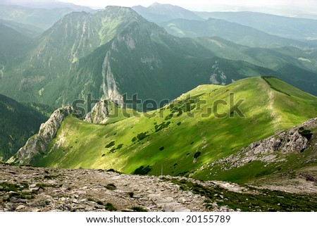 High mountains in the Europe. Landscape with mountain pastures. - stock photo