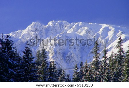High mountains in the winter - stock photo
