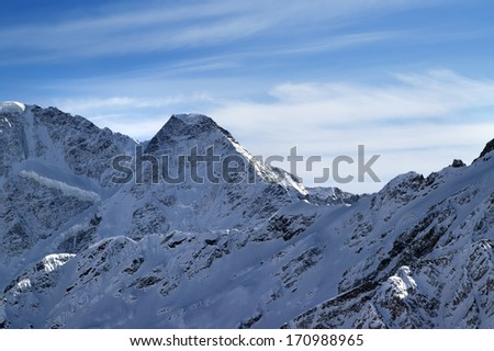 High mountains in winter evening. View from ski slope mt. Elbrus, Caucasus Mountains. - stock photo