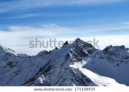 High mountains in winter. View from ski slope mt. Elbrus, Caucasus Mountains. - stock photo