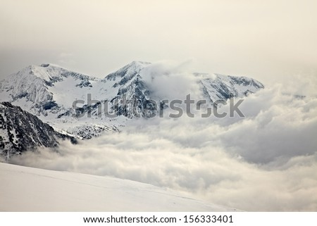 High mountains with winter snow - stock photo
