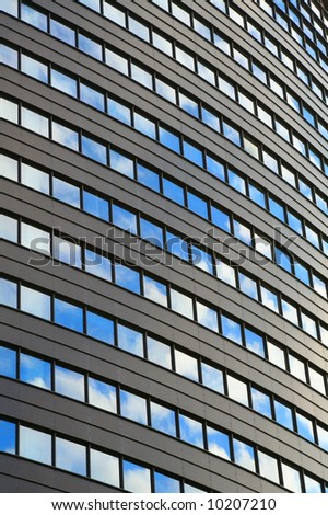 High office building with sky reflecting in the windows - stock photo