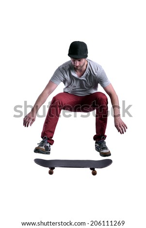high ollie performed by a skateboarder. isolated on white background - stock photo