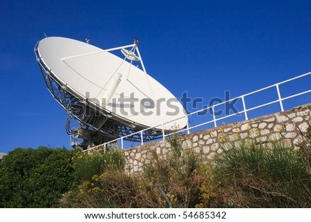 high power satellite antena against clear blue sky - stock photo