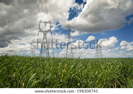 High Power Transmission Line. High power lines stretch far off to the horizon in the Palouse area of eastern Washington state. Electricity generated from Grand Coulee Dam distributed to Washington. - stock photo
