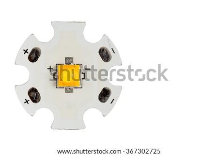 High power warm white smd LED on aluminum star circuit isolated on white. - stock photo