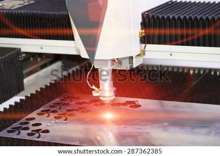 High precision CNC laser cutting metal sheet - stock photo