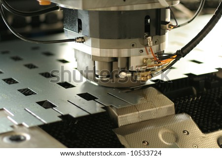 High precision CNC sheet metal stamping and punching machinery. Extreme close up - stock photo