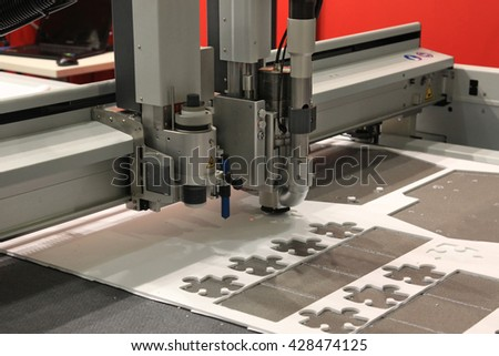 High precision CNC sheet plastic stamping and punching machines - stock photo
