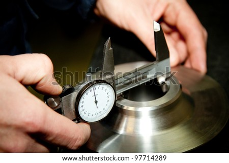 High precision measurement tools in a mechanics plant. Focus on the dial. - stock photo