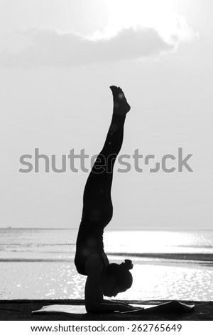 High quality, high resolution, professional yoga woman silhouette at sunset. - stock photo
