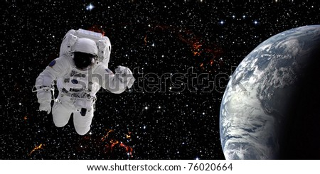 High quality isolated composite astronaut in space - stock photo