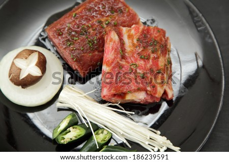 high quality premium Fresh Beef slices on white plate korean grilled menu with vegetable mushroom and bread - stock photo