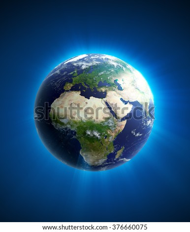 High quality render of Planet Earth with light streak and stars. Africa and Europe is in focus. Transparent water, shaded relief, natural colors, clouds cover. World map courtesy of NASA. - stock photo