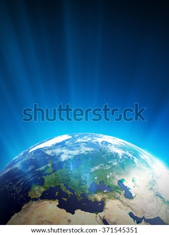 High quality render of Planet Earth with light streaks. Europe is in focus. Transparent water, shaded relief, natural colors, cloud coverage. World map courtesy of NASA. - stock photo