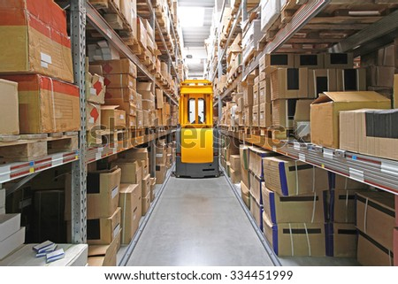 High Rack Stacker Forklift in Warehouse Row
