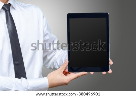 High resolution businessman holding digital tablet