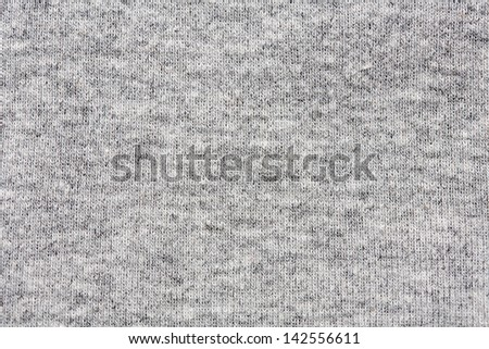 High resolution close up of gray cotton fabric with seams crossing.