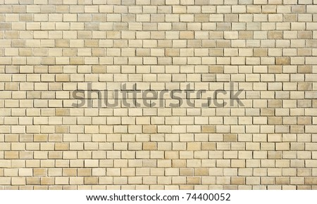 High resolution cream brick wall texture - stock photo