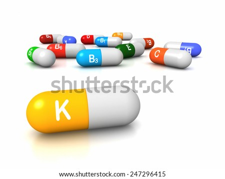 High resolution 3D render of vitamin supplements, focus on Vitamin K Phylloquinone - stock photo