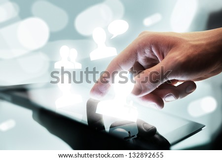 high resolution hand touching digital tablet - stock photo