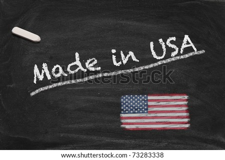 High resolution image with chalk lettering Made in USA and painted US American national flag on black chalkboard. Illustration for quality from the United States of America. - stock photo