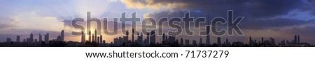High resolution panoramic view of dubai buildings including burj khalifa with beautiful clouds and sunrise background. - stock photo