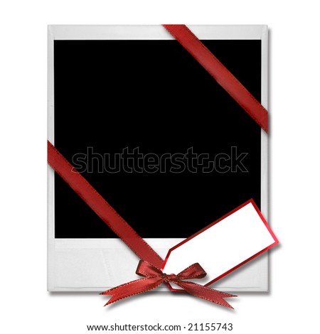 High Resolution Single old Film Blank With Christmas Bow and Gift Tag - stock photo