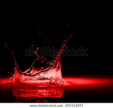 High resolution, splash of red wine on black background - stock photo