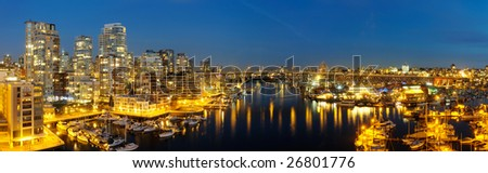 High-resolution stitched image of downtown Vancouver, Granville Bridge and Granville island at dusk. Shot from Burrard's bridge. - stock photo