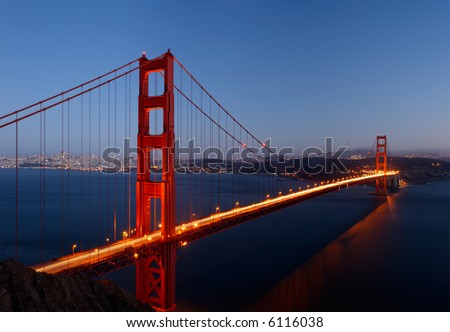 High-resolution stitched image of Golden Gate Bridge glowing in the dusk. - stock photo