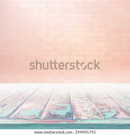 High resolution vintage wood pane and blur brick wall background - stock photo