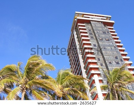 High rise and Palm Trees - stock photo