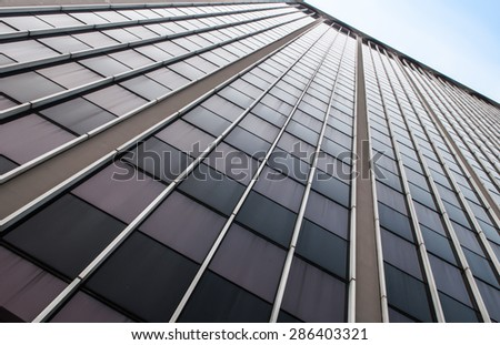 High rise building with window line pattern perspective - stock photo