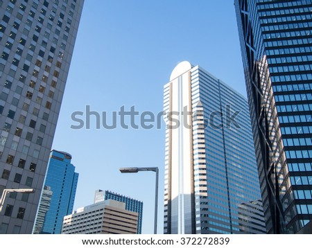 High-rise buildings and blue sky -  Tokyo, Japan - stock photo