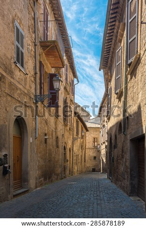 High-rise buildings and narrow streets of the Tuscan, Italian town - stock photo