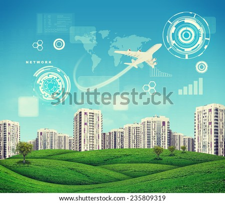 High-rise buildings over green hills with a few trees, jet descending above. Charts, diagrams and other virtual items in sky - stock photo