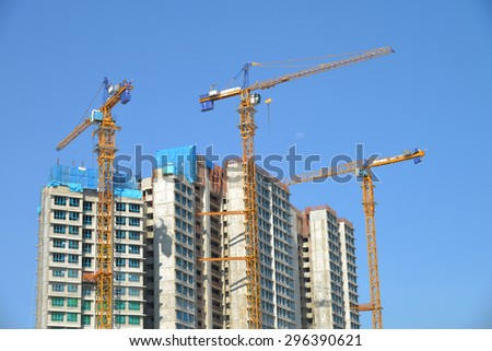 High Rise Buildings Under Construction With Tower Cranes - stock photo