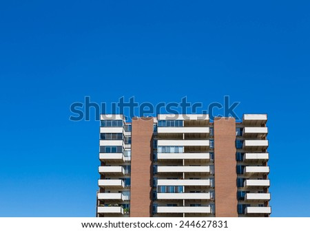 High Rise Condo Building with White Balconies - stock photo